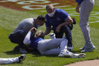 Kansas City Royals' Hunter Dozier is attended to after colliding along the first base line with Chicago White Sox's Jose Abreu in the second inning of the first game of a baseball doubleheader Friday, May 14, 2021, in Chicago. (AP Photo/Charles Rex Arbogast)