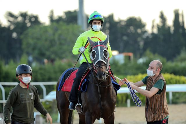 A jockey wears a mask in Istanbul. (Getty Images)