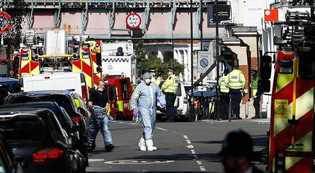 Authorities investigate the scene in southwest London. Source: AAP
