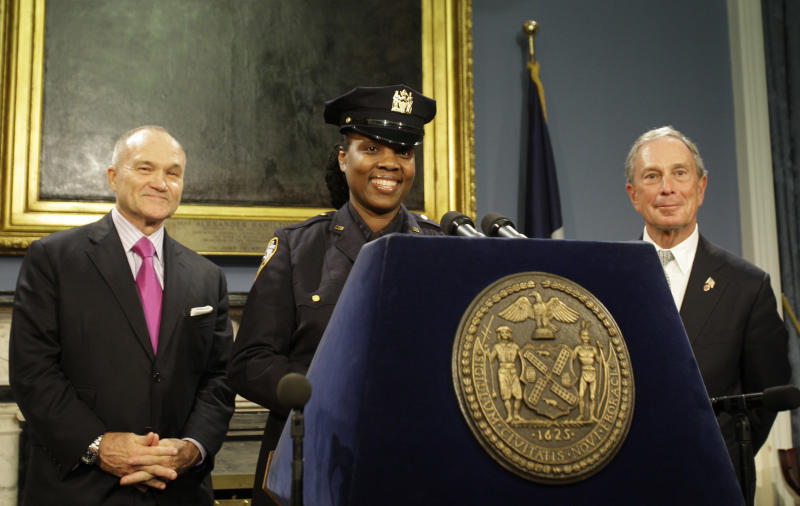 Police officer Feris Jones responds to questions during a news conference after New York City Mayor Michael Bloomberg, right, and Police Commissioner Ray Kelly, left, promoted her to detective Tuesday, Oct. 26, 2010  in New York.  (AP Photo/Frank Franklin II)