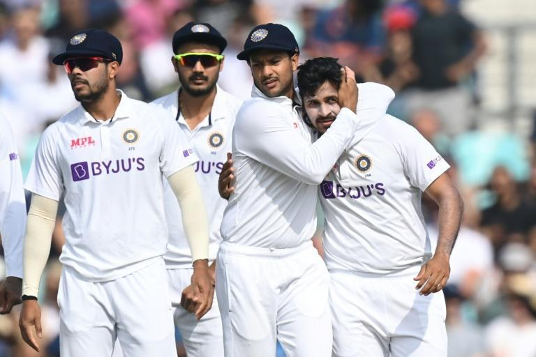 Opening strike: India's Shardul Thakur (R) celebrates with team-mates after dismissing England's Rory Burns in the fourth Test at the Oval (AFP/Glyn KIRK)