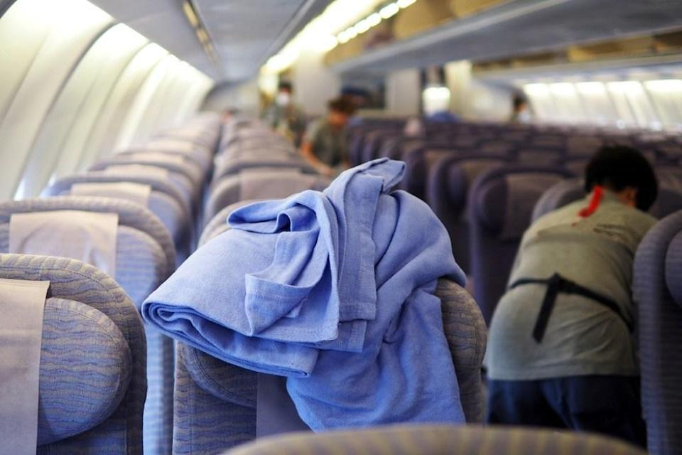 "If you're thinking of cozying up under one of those airplane blankets, think again. According to one report published in the <a href=""https://www.wsj.com/articles/SB117736242824479503"" rel=""nofollow noopener"" target=""_blank"" data-ylk=""slk:Wall Street Journal"" class=""link rapid-noclick-resp""><em>Wall Street Journal</em></a>, some airlines clean their blankets as infrequently as once every 30 days."