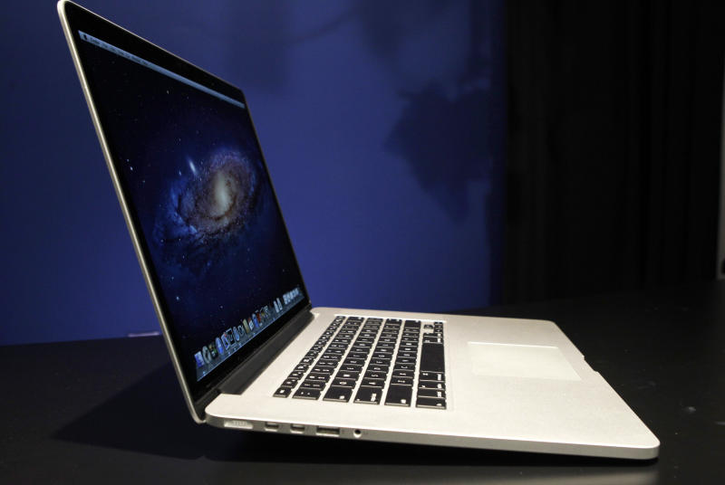 This Wednesday, June 13, 2012 photo shows a profile view of the new 15-inch MacBook Pro with Retina display, in New York.  Apple announced on Wednesday, Feb. 13, 2013,  it has lowered the price of its 13-inch MacBook Pro laptops by $200 and updated its processors. It also launched new models with faster processors and more memory.   (AP Photo/Kathy Willens)