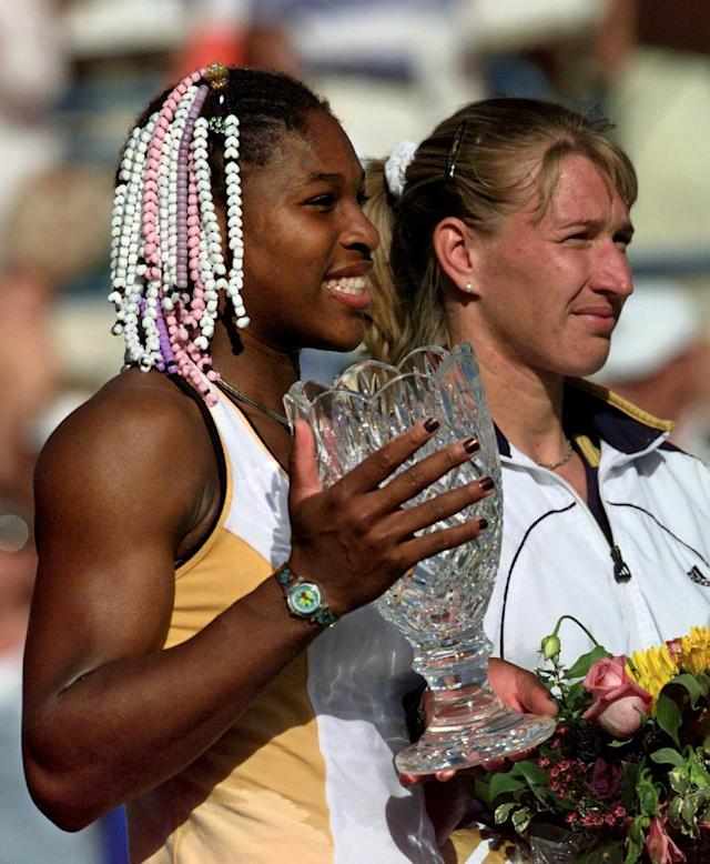 FILE - In this March 13, 1999, file photo, Serena Williams, from Palm Beach Gardens, Fla., holds the Evert Cup tennis tournament trophy as she stands alongside Germany's Steffi Graf after winning 6-3, 3-6, 7-5 in Indian Wells, Calif. Williams earned her 17th major title at the U.S. Open this month. Graf, who won 22 titles, believes Williams will surpass leader Margaret Court at 24. (AP Photo/Kevork Djansezian, File)