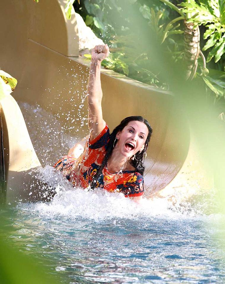 "Wheeeee! Courteney Cox was snapped shooting down a water slide on Tuesday, and it was all in the name of ""work."" The actress and her co-stars have been soaking up the sun all week on the island as they film scenes for a special ""Cougar Town"" episode set in Oahu, Hawaii. If only everyone's job could be as fun! <a href=""http://www.splashnewsonline.com"" target=""new"">Splash News</a> - March 1, 2011"