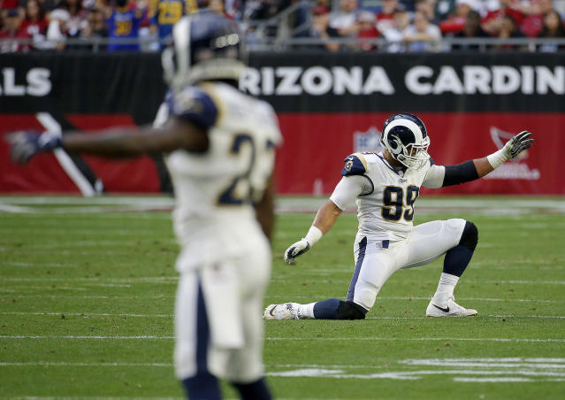 Los Angeles Rams defensive end Aaron Donald (99) celebrates a defensive stop against the Arizona Cardinals during the second half of an NFL football game, Sunday, Dec. 23, 2018, in Glendale, Ariz. (AP Photo/Rick Scuteri)