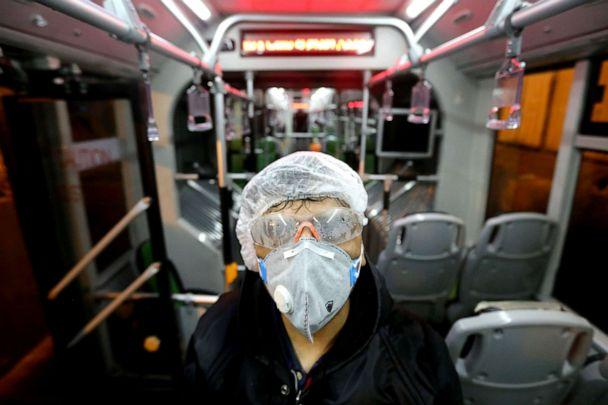 PHOTO: A Tehran Municipality worker cleans a bus to avoid the spread of the novel coronavirus in Tehran, Iran, on Feb. 26, 2020. (Atta Kenare/AFP via Getty Images)