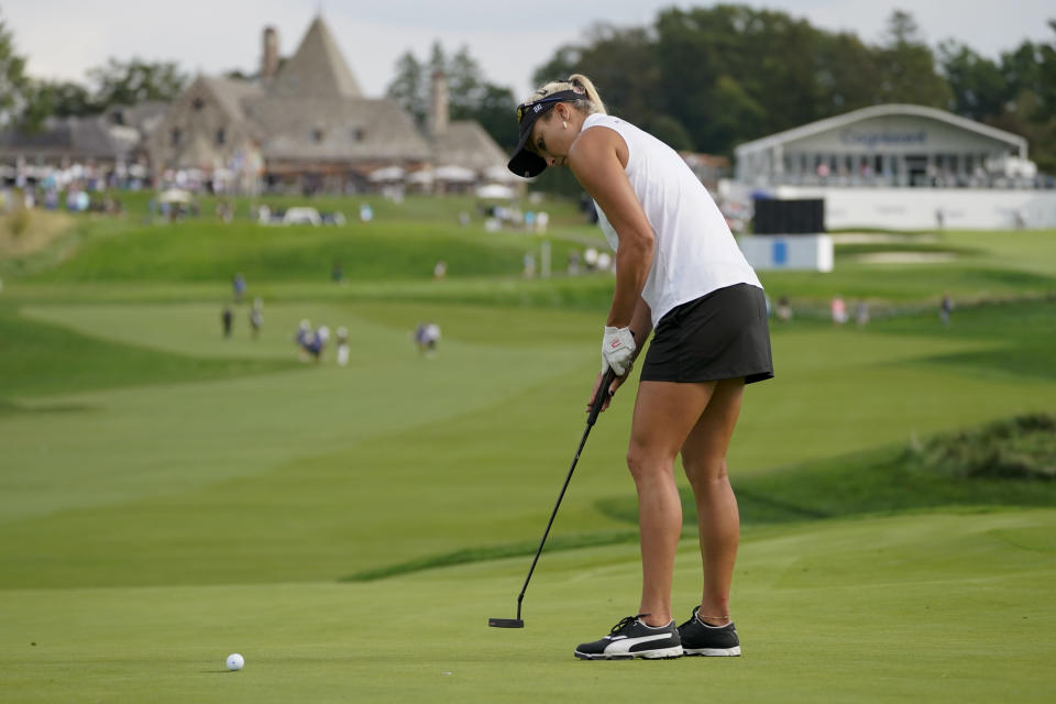 Lexi Thompson sinks her putt on the 10th green in the second round of the Cognizant Founders Cup LPGA golf tournament, Friday, Oct. 8, 2021, in West Caldwell, N.J. (AP Photo/John Minchillo)