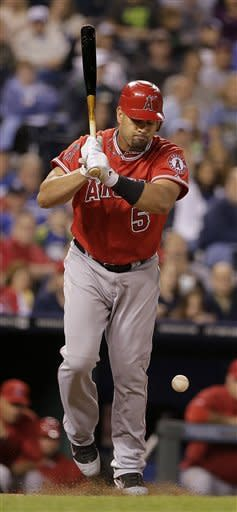 Los Angeles Angels' Albert Pujols is hit by a pitch thrown by Kansas City Royals relief pitcher Tim Collins during the eighth inning of a baseball game on Friday, Sept. 14, 2012, in Kansas City, Mo. (AP Photo/Charlie Riedel)