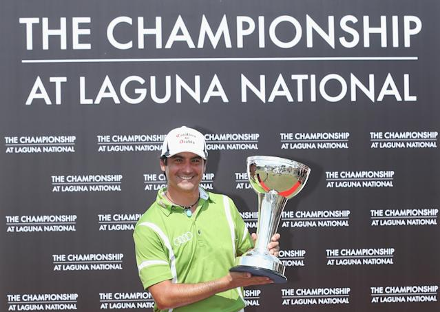 SINGAPORE - MAY 04: Felipe Aguilar of Chile poses with the trophy after winning The Championship at Laguna National held at Laguna National Golf & Country Club on May 4, 2014 in Singapore. (Photo by Andrew Redington/Getty Images)