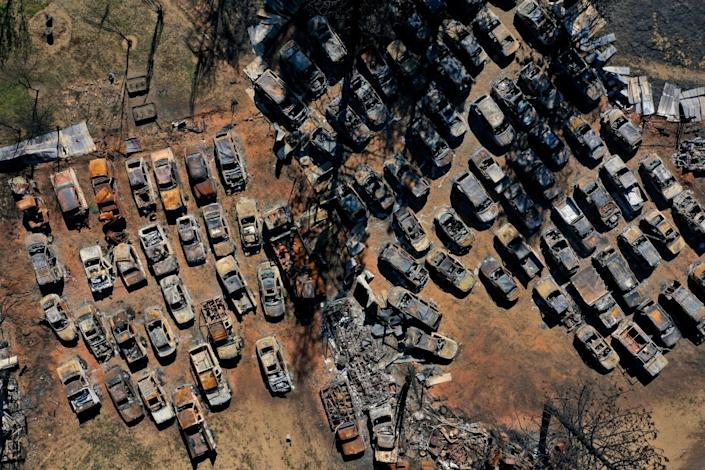 An aerial view of burnt cars