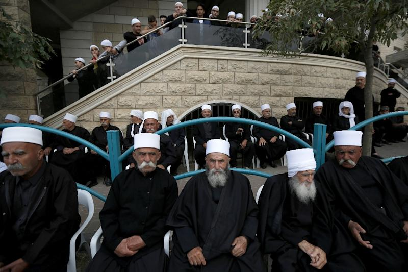 Members of the Druze community photographed in Majdal Shams on the Israeli-annexed Golan Heights (AFP Photo/JALAA MAREY)