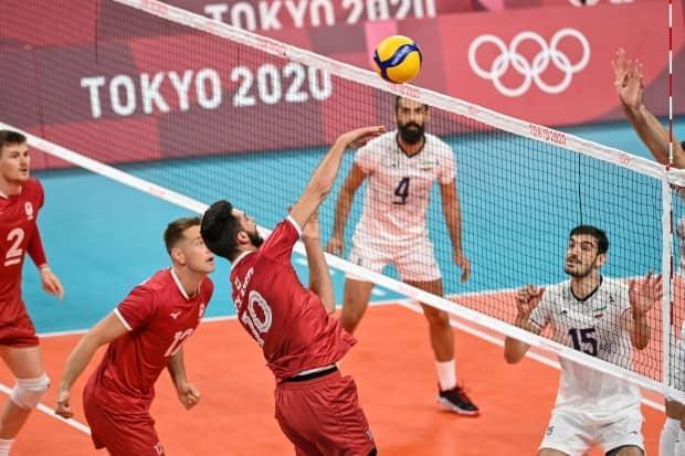 Canada's Ryan Sclater hits the ball in the men's preliminary round pool A volleyball match between Canada and Iran on Wednesday in Tokyo. (Andrej Isakovic/AFP via Getty Images - image credit)