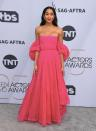 <p>Laura Harrier was pretty in pink on the silver carpet at the 2019 Screen Actors Guild Awards. (Photo: Getty Images) </p>