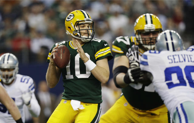 Green Bay Packers quarterback Matt Flynn (10) rolls back to pass against the Dallas Cowboys during the first half of an NFL football game, Sunday, Dec. 15, 2013, in Arlington, Texas. (AP Photo/Tim Sharp)
