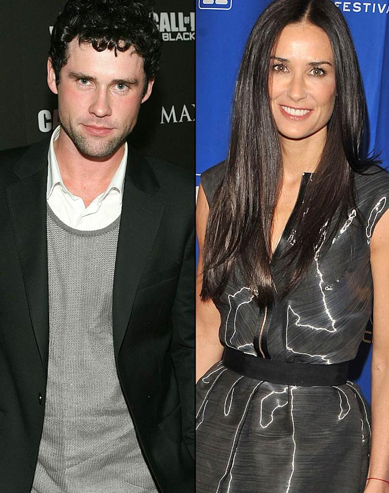 """Demi Moore is """"striking back"""" at Ashton Kutcher for cheating, reports <em>In Touch</em>, which reveals she had an affair with her 27-year-old co-star Ben Hollingsworth. The magazine says Moore and Hollingsworth had """"sex in the back of [her] car"""" one night. But that's not all. For more dish on their steamy trysts, and how Kutcher's dealing with it, log on to <a href=""""http://www.gossipcop.com/demi-moore-ben-hollingsworth-affair-cheating-sex-scandal-ashton-kutcher/"""">Gossip Cop</a>."""