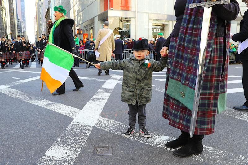 A youngster waves a flag while marching in the St. Patrick's Day Parade, March 16, 2019 in New York. (Photo: Gordon Donovan/Yahoo News)