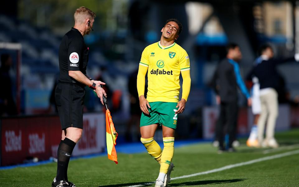 Max Aarons of Norwich City protests to the linesman during the Sky Bet Championship match between Huddersfield Town - Getty Images