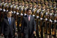 China's Premier Li Keqiang and Prime Minister Justin Trudeau review an honor guard during a welcome ceremony at the Great Hall of the People in Beijing, China, on Aug. 31, 2016. (AP Photo/Mark Schiefelbein)