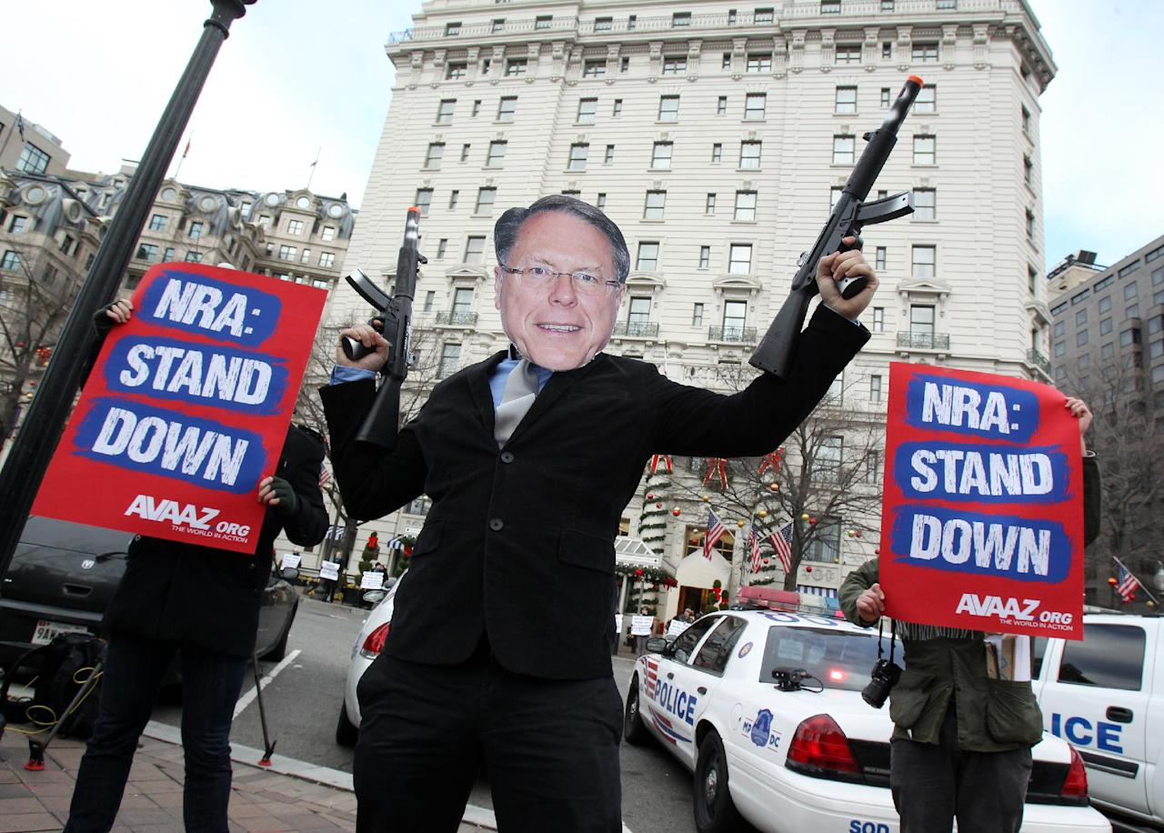"IMAGE DISTRIBUTED FOR AVAAZ- Members of the activist group Avaaz protest today's NRA press conference with a likeness of NRA CEO Wayne LaPierre Jr., calling on NRA affiliates like Days Inn and Super 8 to get ""out of bed"" with the gun lobby, outside the Willard Hotel in Washington, Friday, Dec. 21, 2012. (Paul Morigi / AP Images for Avaaz)"