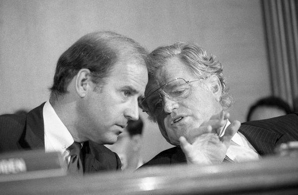 <p>Biden confers with Senator Ed Kennedy of Massachusetts during a Senate confirmation hearing for Chief Justice nominee William Rehnquist.</p>