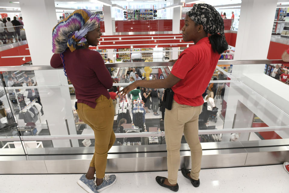 DENVER, CO - JULY 17: Target employees Nicole Misagwe, left, and Dina Atambwe, right, chat during a sneak peek of the new Target store on July 17, 2018, in Denver, Colorado. This is the second urban Target store in Denver. The store, which is smaller than most Targets, will carry everything most Targets have including clothing and food. The grand opening of the store for the public will be on Sunday July 22, 2018. (Photo by Helen H. Richardson/The Denver Post via Getty Images)
