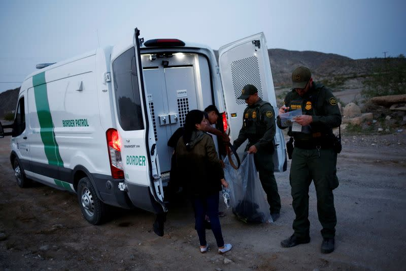 FILE PHOTO: Migrants from Central America crossing into the United States from Mexico, in New Mexico