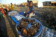 Fish, eggs and bread on sale by Ethiopian refugees to their peers