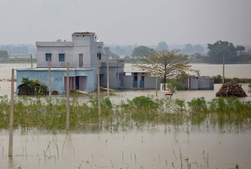 A partially submerged government building is seen in a flooded area in Bhagalpur district