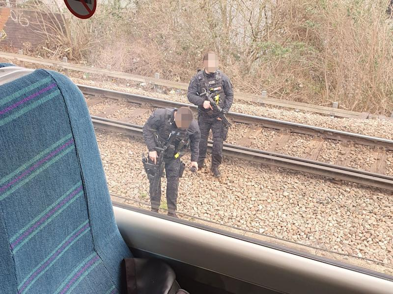 Armed police responding to an incident on a train at Queens Road Peckham railway station on 18 February: Twitter/@HeyItsAlexM