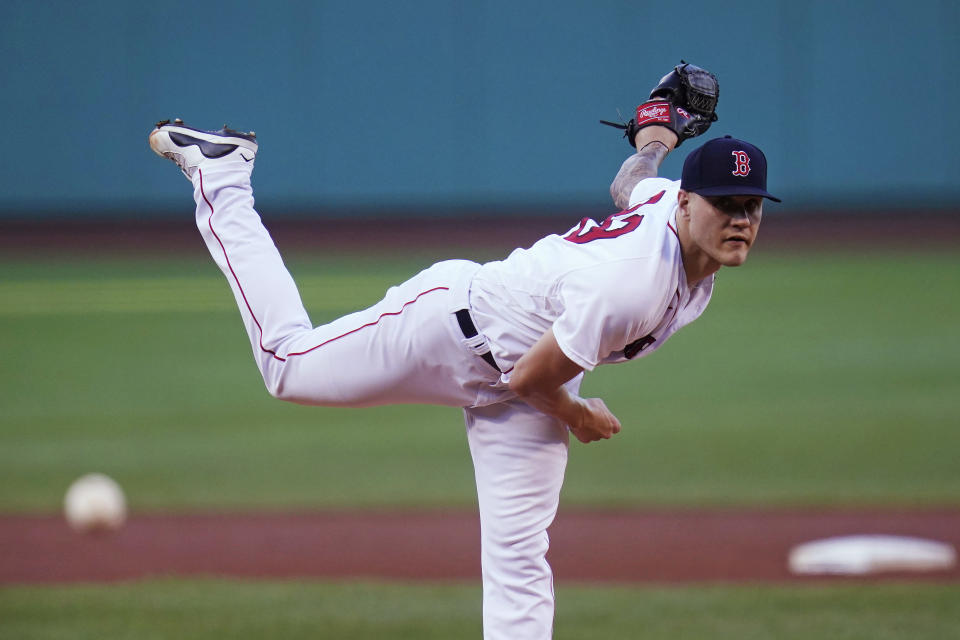Boston Red Sox starting pitcher Tanner Houck delivers during the first inning of the second baseball game of a doubleheader against the Toronto Blue Jays at Fenway Park, Wednesday, July 28, 2021, in Boston. (AP Photo/Charles Krupa)