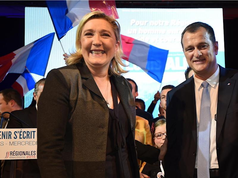 Marine Le Pen and her companion Louis Aliot during a meeting in Nimes, France (PASCAL GUYOT/AFP/Getty Images)