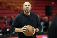 FILE - In this Dec. 13, 2019, file photo, Los Angeles Lakers assistant coach Jason Kidd works with players before an NBA basketball game against the Miami Heat in Miami. Kidd is coming back to Dallas again, this time to replace the coach he won a championship with as the point guard of the Mavericks 10 years ago. A person with direct knowledge of the agreement says Kidd and the Mavericks agreed on a contract Friday, June 25, 2021, eight days after Carlisle resigned abruptly in the wake of general manager Donnie Nelson's departure. (AP Photo/Lynne Sladky, File)