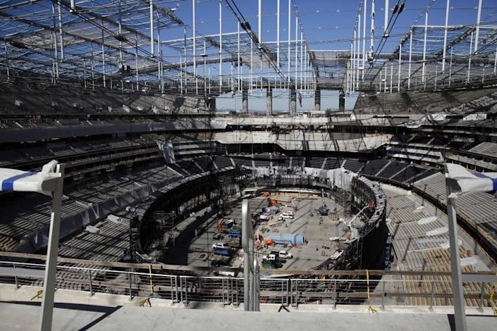 """Construction of the SoFi Stadium and Hollywood Park, the future home of the Chargers and Rams, shown on Feb. 26. <span class=""""copyright"""">(Dania Maxwell / Los Angeles Times)</span>"""