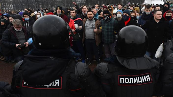 """<div class=""""inline-image__caption""""><p>""""People attend a rally in support of jailed opposition leader Alexei Navalny in Saint Petersburg on January 23, 2021.""""</p></div> <div class=""""inline-image__credit"""">Olga Maltseva/Getty</div>"""