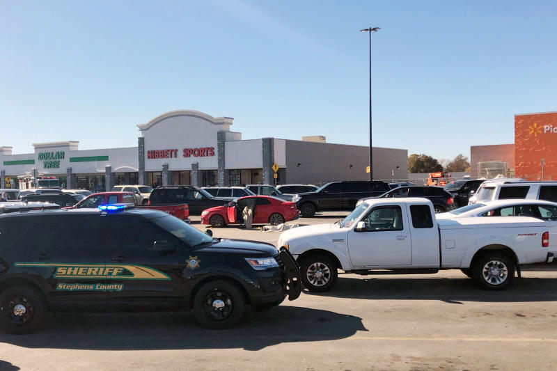 Picture of a sheriff's department car outside the shopping centre where three people were killed in a shooting in Oklahoma
