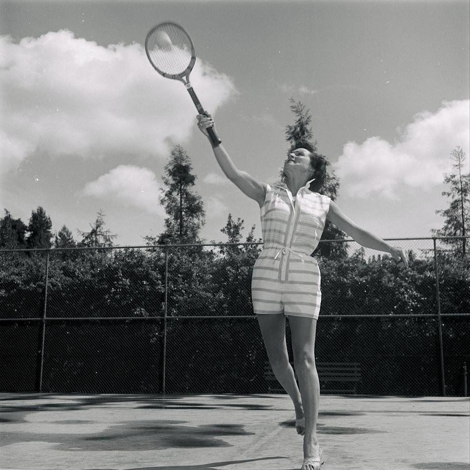 <p>Betty White, television's favorite <em>Golden Girl,</em> gives it her all on the tennis court during a TV appearance on May 4, 1957.</p>