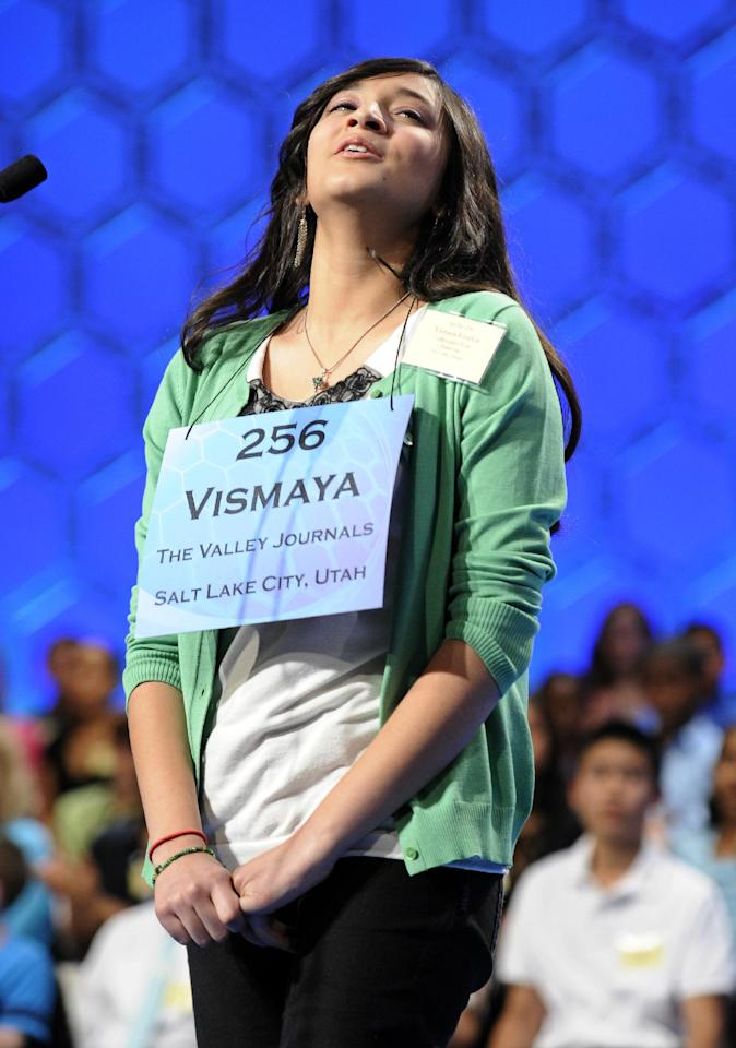 "Vismaya Kharkar, 14, of Bountiful, Utah, reacts to correctly spelling ""sciomancy"" during the final round of the Scripps National Spelling Bee in Oxon Hill, Md., Thursday, May 30, 2013. (AP Photo/Cliff Owen)"