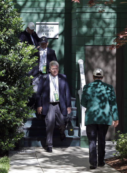 Members of the rules committee leave an administration building after meeting before the third round of the Masters golf tournament Saturday, April 13, 2013, in Augusta, Ga. Tigers Woods was assessed a 2-stroke penalty for a drop in second round of the Masters. (AP Photo/Darron Cummings)