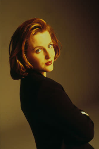 "<div class=""caption-credit""> Photo by: Moviestore Collection/RexUSA</div><div class=""caption-title""></div><b>Dana Scully, The X-Files</b> <br> <br> If you regularly had to flee from voracious liver-eating freaks and investigate freaky fluke-man hybrids, you'd have bigger issues to tackle than varying your look, right? What Scully may have lacked in fashion sense, she nailed in her no-nonsense, professional style. Matte skin, red hair, and brownish-red lips were so '90s - and effective in capturing the attention of one ""Spooky"" Mulder, too. <br> <br>"