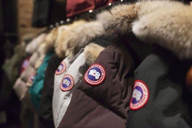 Jackets are on display at the Canada Goose showroom in Toronto in November 2013. Canada Goose Holdings has been fined around $88,000 by China for allegedly making misleading claims about the materials it uses. (Aaron Vincent Elkaim/The Canadian Press - image credit)