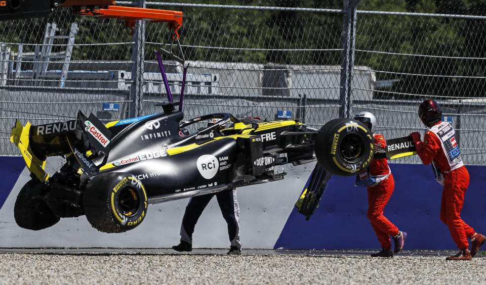 The car of Renault driver Daniel Ricciardo of Australia is lifted after crashing into the barriers during the second practice session for the Styrian Formula One Grand Prix at the Red Bull Ring racetrack in Spielberg, Austria, Friday, July 10, 2020. The Styrian F1 Grand Prix will be held on Sunday. (Leonhard Foeger/Pool via AP)