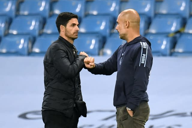 Manchester City manager Pep Guardiola, right, was facing his old assistant Mikel Arteta