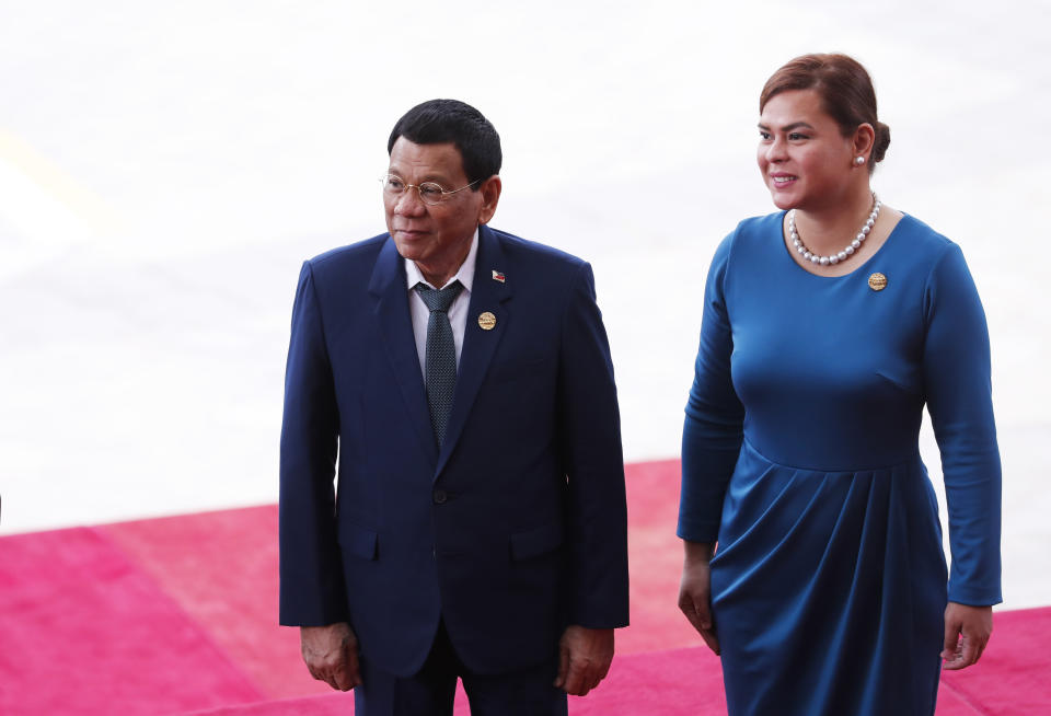 FILE PHOTO: Philippine President Rodrigo Duterte (L) and his daughter Sara Duterte arrive for the opening of the Boao Forum for Asia (BFA) Annual Conference 2018 in Boao, south China's Hainan province on April 10, 2018. (Photo: AFP via Getty Images)