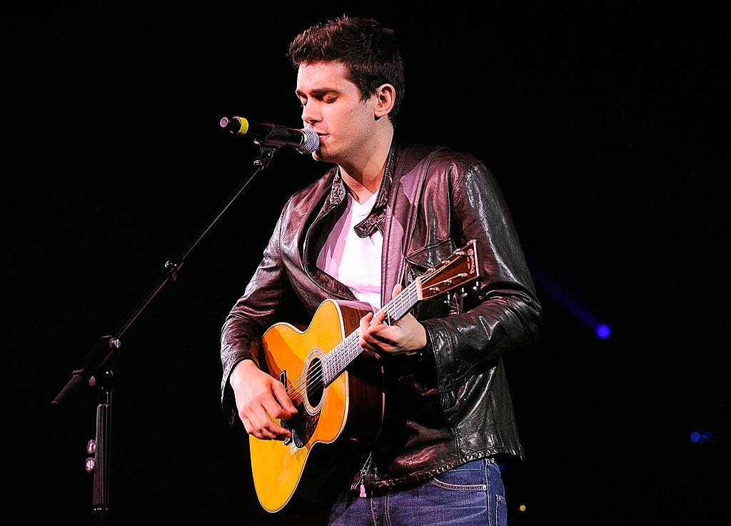 """John Mayer gets up close and personal with his mic. Larry Busacca/<a href=""""http://www.wireimage.com"""" target=""""new"""">WireImage.com</a> - May 17, 2008"""
