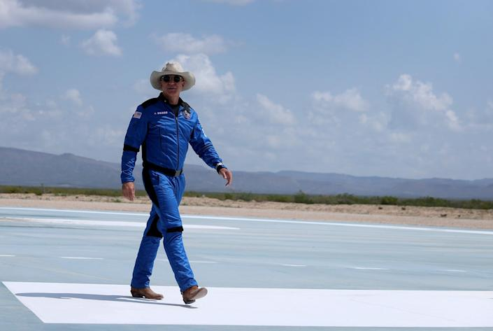 Jeff Bezos walks near Blue Origin's New Shepard after flying into space (Getty Images)