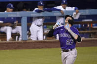 Colorado Rockies' Trevor Story looks up as he approaches home on a solo home run during the sixth inning of a baseball game against the Los Angeles Dodgers on Friday, July 23, 2021, in Los Angeles. (AP Photo/Mark J. Terrill)