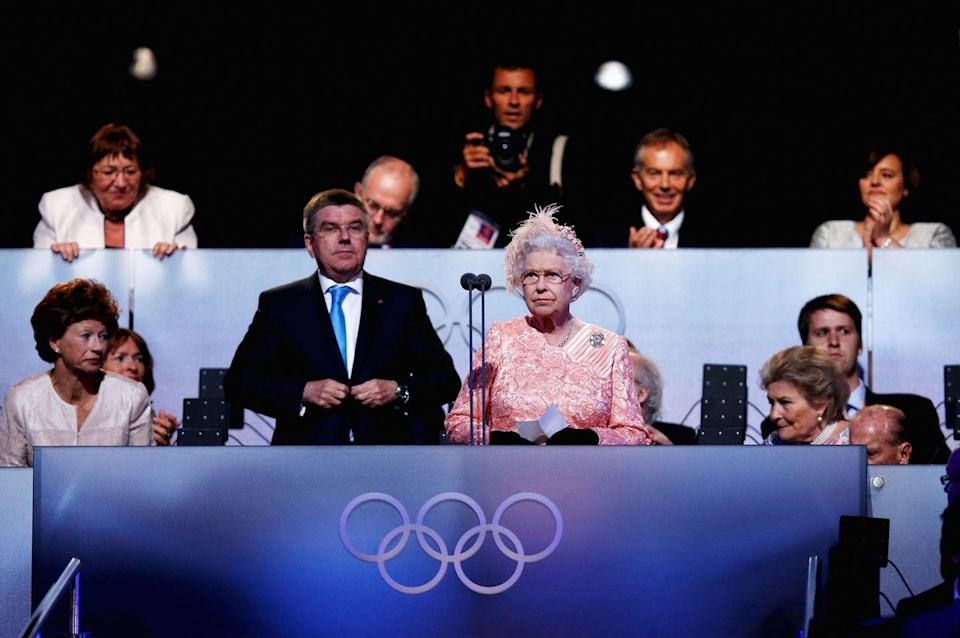 """<p>Queen Elizabeth makes remarks at the 2012 London opening ceremony. This was moments after organizers created a fun introduction featuring the 007 character James Bond (<strong>Daniel Craig</strong>) and made it seem as though Her Majesty <a href=""""https://www.youtube.com/watch?v=1AS-dCdYZbo"""" rel=""""nofollow noopener"""" target=""""_blank"""" data-ylk=""""slk:arrived by sky-diving"""" class=""""link rapid-noclick-resp"""">arrived by sky-diving</a> into the stadium. </p>"""
