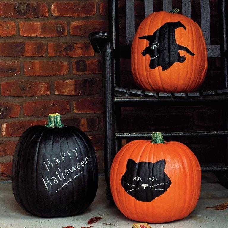 <p>All you need is black paint and chalk to replicate this chalk-board-inspired pumpkin. Simply coat your pumpkin in black paint and use chalk to write or draw whatever your heart desires. </p>