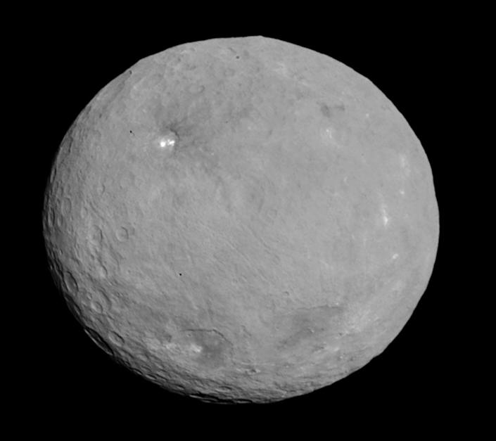 The largest object in the asteroid belt is the circular shaped Ceres. Since 2015, NASA's Dawn spacecraft has orbited and photographed the nearly 600-mile-wide dwarf planet, including its numerous brightly lit areas, like the two bright lights of the crater called Occator.